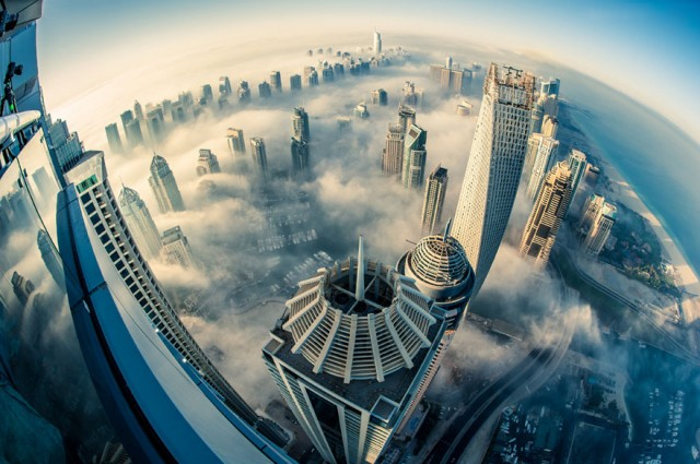 a-blaze-with-light-dubai-in-fog-sebastian-opitz-1