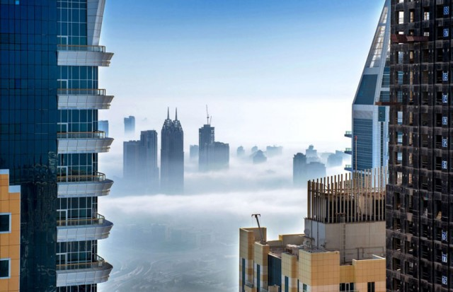 a-blaze-with-light-dubai-in-fog-sebastian-opitz-2